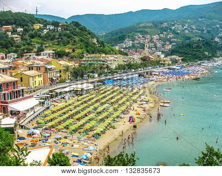 Moneglia, Liguria, Italy - circa June 2010: aerial view of one of popular beaches of the tourist resorts of the Ligurian coast in summer.
