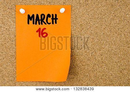 16 March Written On Orange Paper Note