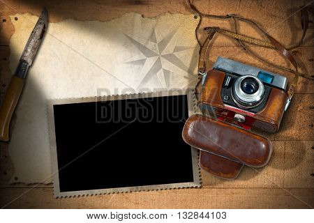 Old and vintage camera with leather case empty parchment photo frame and a pen knife. Template for adventurous travels