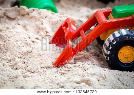 toys for kids in the sandbox the tractor picks up the sand