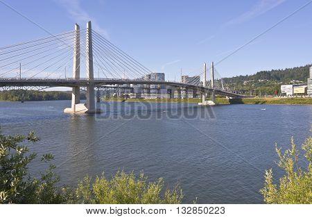 Tillikum crossing bridge and kayaks in the river.