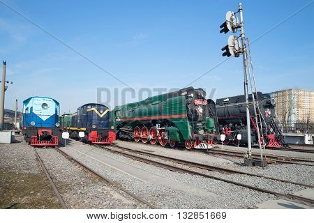 SAINT PETERSBURG, RUSSIA - MARCH 30, 2016: Shunting locomotives and two of the Soviet steam locomotive on the October railway. Historical landmark of the city  Saint Petersburg