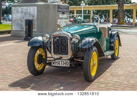Wellington New Zealand - November 19 2014: Classic 1935 vintage Austin Seven car parked on Marine Parade in the art deco town of Napier Hawke's Bay New Zealand.