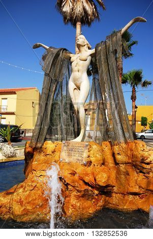 DUQUESA, SPAIN - JULY 18, 2008 - Fountain in recognition of seamen who have dedicated their lives to hard work at sea Duquesa Malaga Province Andalucia Spain Western Europe, July 18, 2008.