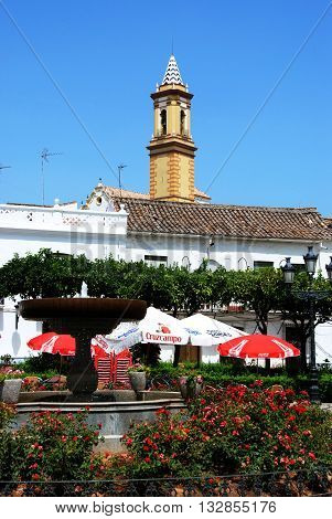 ESTEPONA., SPAIN - JULY 18, 2008 - Fountain and pavement cafes in the Plaza las flores Estepona Malaga Province Andalucia Spain Western Europe, July 18, 2008.