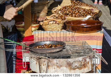 Chestnut and corn roasts in street .They ara some of the most common street foods in the city