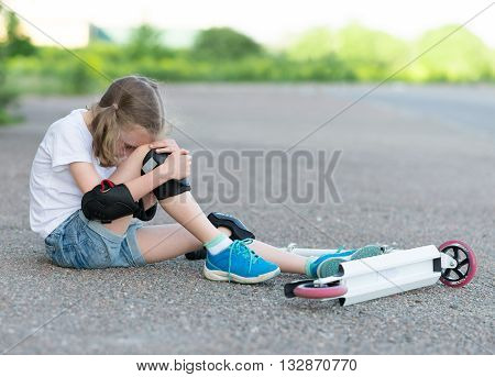 Little Girl Fell From The Scooter On The Street.