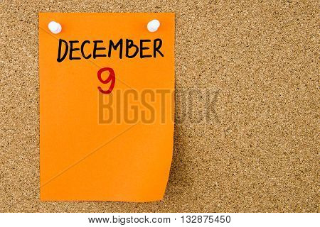 9 December Written On Orange Paper Note