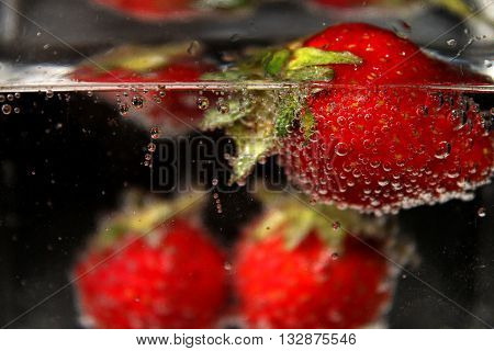 Fresh fruit in mineral water with bubbles.