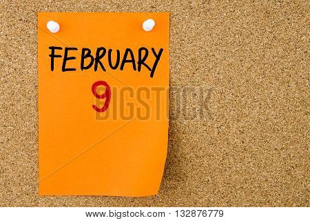 9 February Written On Orange Paper Note