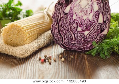 Pasta with cabbage greens and papper on the wooden table for dinner