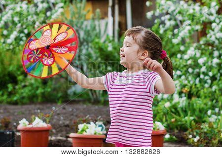 little girl having fun on a summer evening on the dacha