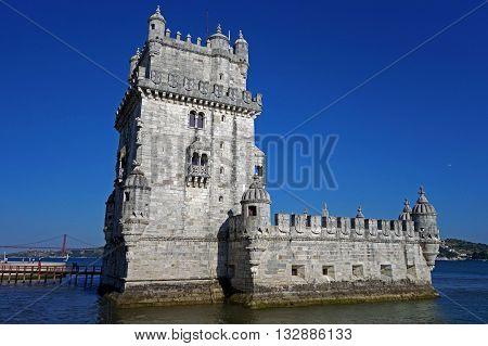 LISBON, PORTUGAL: JUNE 17, 2015: Belem tower on the Tagus river captured during a sunny afternoon, Belem, Lisbon, Portugal