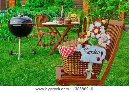 Close-up Of Chair With Hamper And Sign Garden, Party Scene