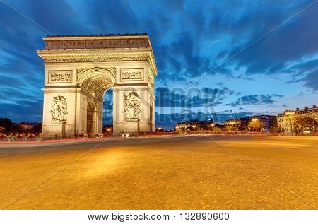 The famous Arc de Triomphe in Paris at dawn poster