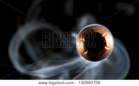 Copper plated bullet with a cavity on the nose pointed at the camera