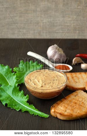 Pate Apetiser with melba toast soldiers and small salad on dark slate background.