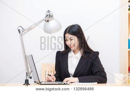 Asian Beautiful Modern Business Woman Using Lapyop Computer