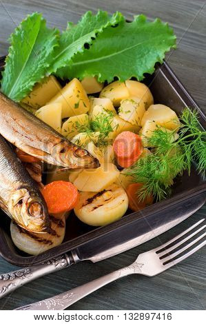 boiled potatoes with herbs and sprats, vegetables