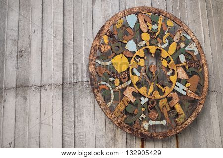 old decoration on wooden wall rusty decoration circle decoration item antique decoration colorful decoration