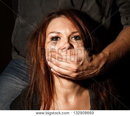 Female mouth grasps the man's hand. concepr of domestic violence