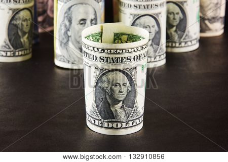 Dollar bills against other bills dollorovyh Portrait of George Washington bill dollar cylinder twisted currency money portraits of presidents signs business finance condition cash