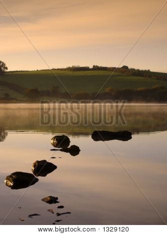 Dawn On A Misty Irish Lake