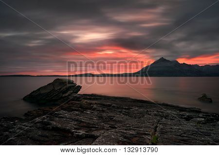 Loch Scavaig with Cuillins mountains in red sunset light Isle of Skye Scotland
