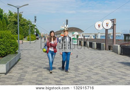 DNEPR UKRAINE - MAY 21 2016:Young couple walking on the Dnepr river embankment at May 21 2016 in Dnepr Ukraine