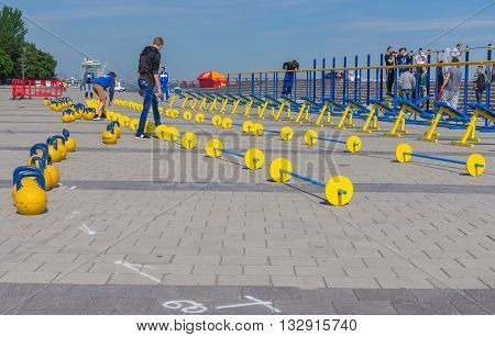 DNEPR UKRAINE - MAY 21 2016:Young people working on the Dnepr river embankment preparing for workout festival at May 21 2016 in Dnepr Ukraine