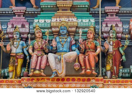 Chettinad India - October 17 2013: Colorful statue of Lord Shiva and entourage at Kothamargalam Mariamman temple. He is surrounded by his consorts.