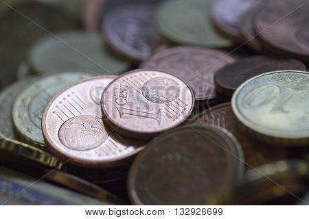 A closeup of euro cent coins in a cup