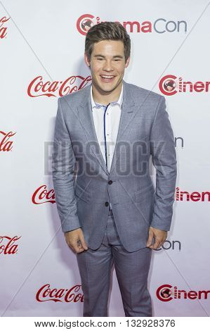 LAS VEGAS - APRIL 14 : Actor Adam DeVine one of the recipients of the Comedy Stars of the Year Award attends the CinemaCon Big Screen Achievement Awards at The Caesars Palace on April 14 2016 in Las Vegas