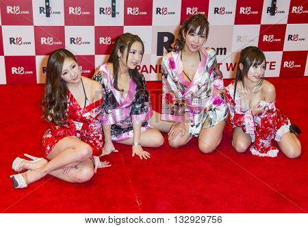 LAS VEGAS - JAN 23 : Unidentified Adult film actresses at the Japanese R18.com booth at the 2016 AVN Adult Entertainment Expo at the Hard Rock Hotel & Casino on January 23 2016 in Las Vegas.