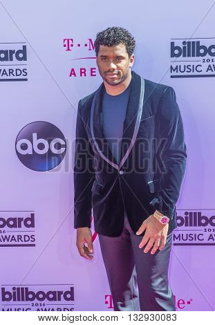 LAS VEGAS - MAY 22 : NFL player Russell Wilson attends the 2016 Billboard Music Awards at T-Mobile Arena on May 22 2016 in Las Vegas Nevada.