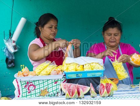 PANCHIMALCO EL SALVADOR - MAY 08 : A Salvadorian women sells fruits during the Flower & Palm Festival in Panchimalco El Salvador on May 08 2016