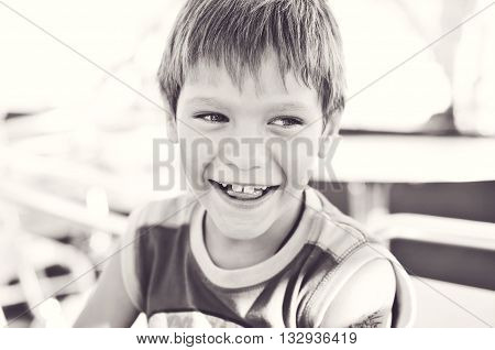 happy and laughing funny little boy outdoors