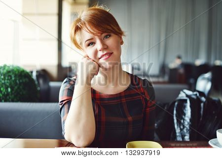Redhead Woman In Cafe