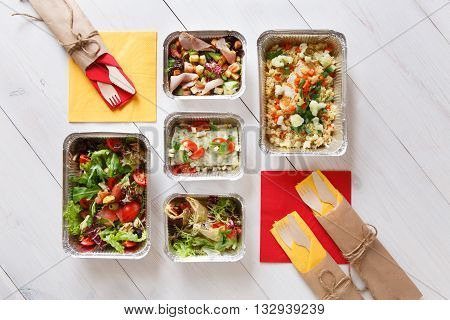 Healthy eating, diet concept. Healthy lunch. Take and go organic food. Weight loss diet, low carb food take away in aluminium boxes. Healthy food background. Salads and meat at white wooden table