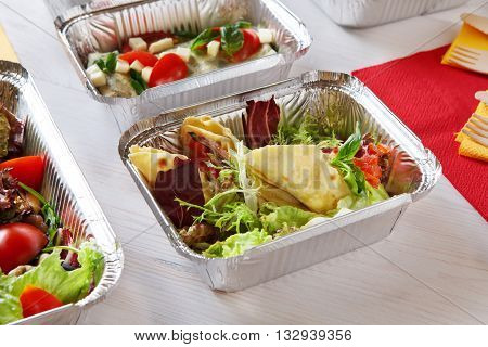 Healthy lunch. Natural organic food. Weight loss diet, low carb food take away in aluminium boxes. Healthy food closeup background. Salads and meat at white wooden table
