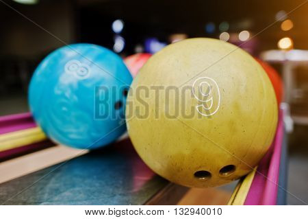 Two Colored Bowling Balls Of Number 9 And 8