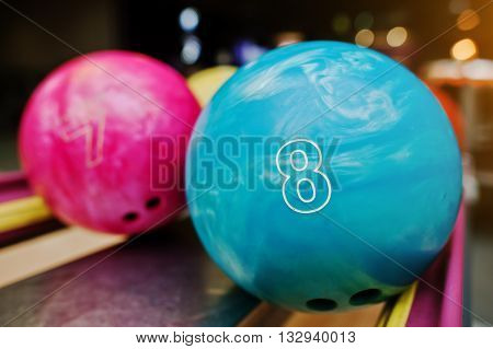 Two Colored Bowling Balls Of Number 8 And 7. Kids Ball For Bowling