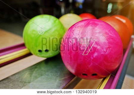 Two Colored Bowling Balls Of Number 7 And 6. Kids Ball For Bowling