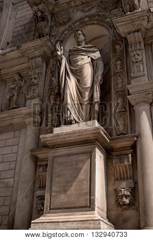 Milan Italy - May 25 2016: Giureconsulti palace. Sculpture Sancti Ambrosii. The sculpture is located in an alcove and ornate.