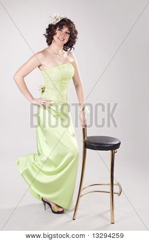 Yound Smiling Girl In Long Green Dress
