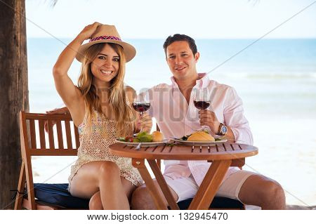 Pretty Young Couple Eating At The Beach
