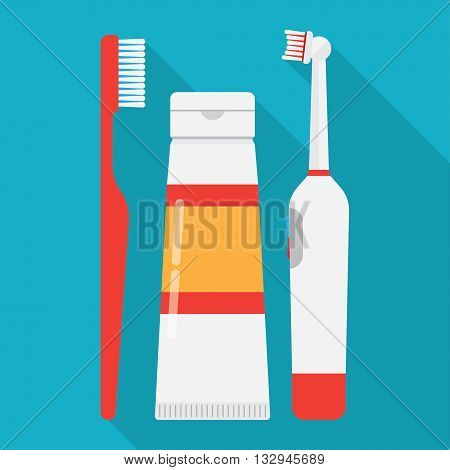 tooth brushes toothpaste and Electric Toothbrush isolated on blue background.