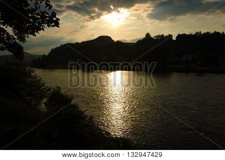 Sunset over river Dunajec in village Stromowce Nizne and Cerveny Klastor