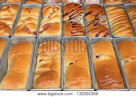 loaf of freshly baked in tray bread from the oven a modern bakery.