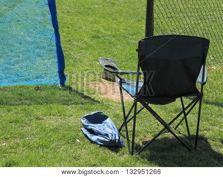 Local outdoor sports chair with beverage holder for the local sports fan on a sunny day.